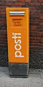 Orange post box in Helsinki, Finland